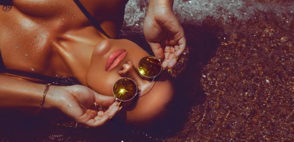 tan woman on beach
